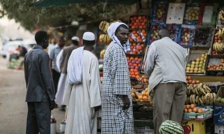 Men shop for fruit in Sudan's capital, Khartoum.