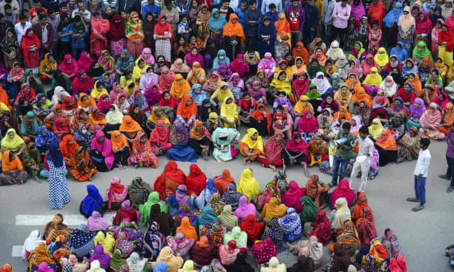 Garment workers block a road during a demonstration to demand higher wages in Dhaka earlier this year.