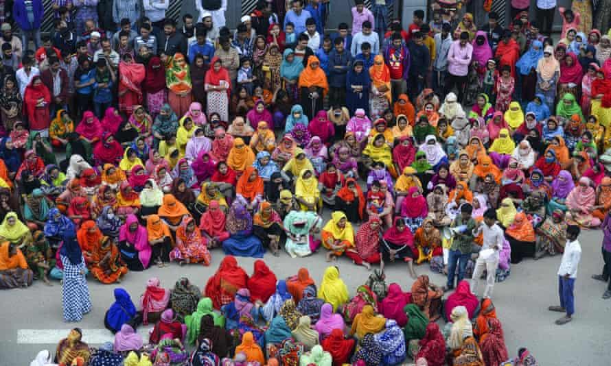 Bangladeshi garment workers block a road