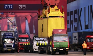 Trucks line up at a container port in Qingdao, east China.