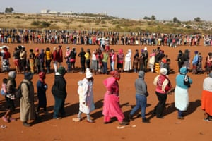 Pretoria, South Africa. People queue to receive food aid amid the spread of the coronavirus disease, at the Itireleng informal settlement