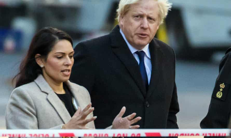 Boris Johnson, right, and Priti Patel at the crime scene near London Bridge