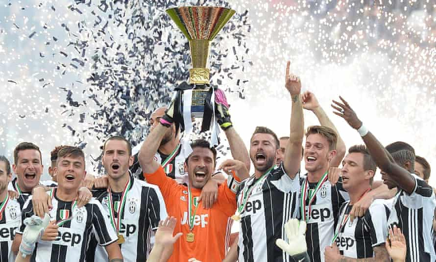 Juventus players celebrate with the Scudetto.