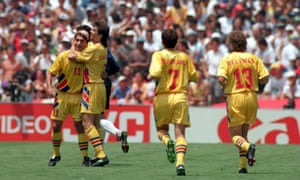 Ilie Dumitrescu celebrates with his Romania team-mates after finding the net against Argentina at USA 94.