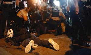 White militiamen roam Ferguson with rifles while black men