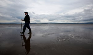 a guide finds a safe way across the the sands of Morecambe Bay.