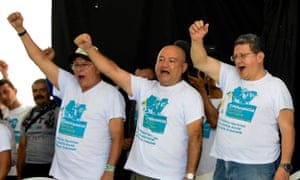 Farc leaders, from left, Ricardo Tellez, Carlos Antonio Lozada and Pablo Catatumbo celebrate the approval of the peace deal on Friday.