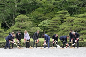 G7 leaders take part in a tree planting ceremony during a visit to Ise Jingu Shrine in Japan