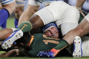 Italy's hooker Luca Bigi peers out from near the bottom of a ruck during the match against South Africa at the Shizuoka Stadium Ecopa.