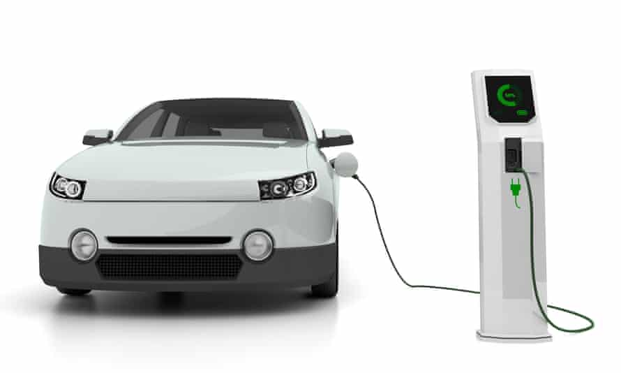 Electric car attached to charging point