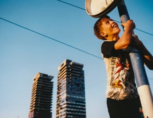 Nusret, aged 12, plays next to the destroyed UNIS Towers in Sarajevo's financial centre in June 1997.