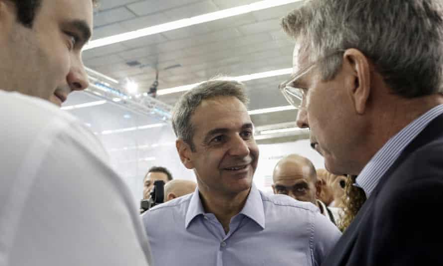 Greek Prime Minister Kyriakos Mitsotakis (C) and Minister of Digital Governance Kyriakos Pierrakakis (L) chat with US Ambassador to Greece Geoffrey Pyatt (R) in Thessaloniki, September 2019.