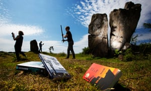 Print Point's Karen Latto and fellow Bute Noir organising committee member Ann Spiers at standing stones with books