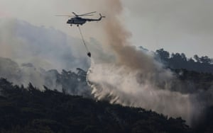 A firefighting helicopter drops water in Marmaris district, Turkey