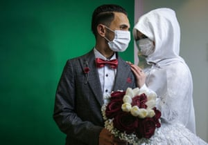 Gaza Strip. Palestinian groom Mohamed abu Daga and his bride Israa at their studio photoshoot before their wedding ceremony in Khan Yunis