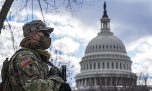 Members of the National Guard stand watch at the US Capitol in Washington DC.
