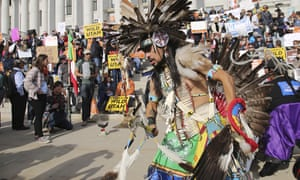A supporter of the Bears Ears and Grand Staircase-Escalante national monuments dances with a headdress during a rally on Saturday in Salt Lake City.