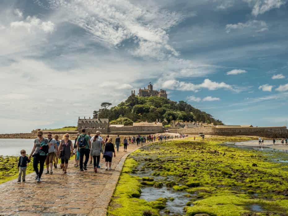 Visitors walk across the causeway to St Michael's Mount.