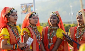 Traditional folk dancers from the state of Madhya Pradesh take part in the ceremony