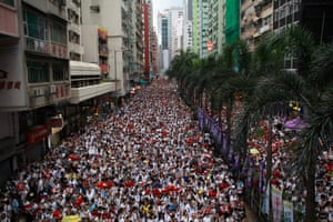 Hundreds of thousands of protesters march through Hong Kong