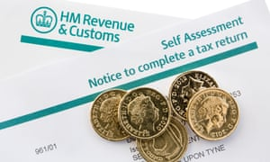 HM Revenue & Customs self assessment notice with some pound coins on it