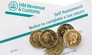 HMRC self-assessment form and coins