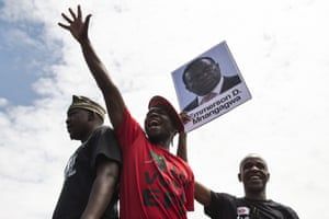 Protesting University of Zimbabwe students hold a portrait of the country's former vice president, Emmerson Mnangagwa.