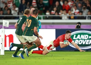 Josh Adams goes over to score for Wales.