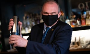 The Lib Dem leader Sir Ed Davey making a cocktail during a visit to Bar Bodega in Watford today.