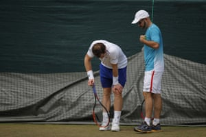 2017: The injury strain begins to show as Murray holds his knee during a training session on day six of Wimbledon
