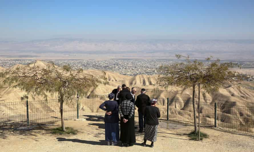Jewish settlers at a viewpoint in the Judean desert overlooking the West Bank city of Jericho.