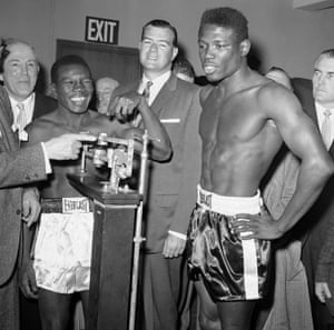 Welterweight champion Benny Paret, left, and former champion Emile Griffith at the weigh-in for the 1962 bout.