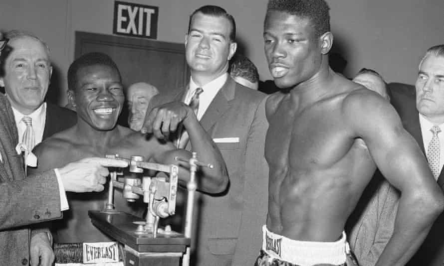 Benny Paret laughs as he reads the weight of challenger Emile Griffith during the weigh-in at the Garden in New York, the scene of their fateful fight.