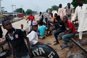 A group of displaced children and youngsters live next to the train tracks in West End, Maiduguri.