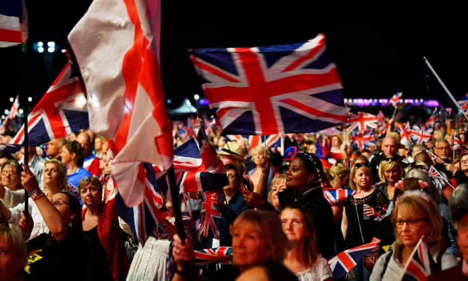 People celebrate The Last Night of the Proms in Hyde Park, London, in 2018.