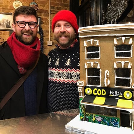 Jonathan Armistead and Oliver Singleton with their gingerbread re-creation of Cod Fellas fish and chip shop in Peckham, south London.