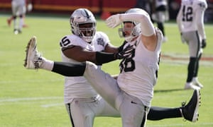 The Las Vegas Raiders celebrate a sack of Patrick Mahomes, who was harried all day