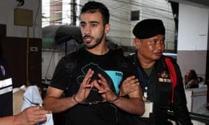 Refugee footballer Hakeem al-Araibi is led into a court in Bangkok on 11 December.