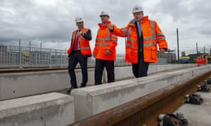 Boris Johnson visits a tramline under construction in Stretford, Greater Manchester, with Transport for the North boss, Barry White, left.