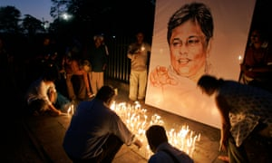 Activists and members of Sri Lankan civil societies light candles in front of a portrait of Sunday Leader newspaper editor Lasantha Wickrematunge in a silent vigil condemning his killing in Colombo.