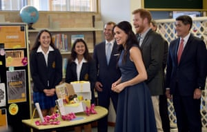 Britain's Prince Harry and Meghan, Duchess of Sussex react during a visit to Macarthur Girls High School in Sydney, Australia, Friday, Oct. 19, 2018. Prince Harry and his wife Meghan are on day four of their 16-day tour of Australia and the South Pacific. (Peter Parks/Pool Photo via AP)