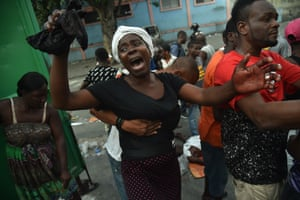 Port-au-Prince, Haiti: A mother cries beside the body of her son