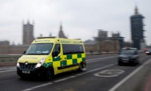 An ambulance crosses Westminster Bridge on December 28 in London.