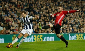 Wayne Rooney attempts to block Craig Dawson's cross.