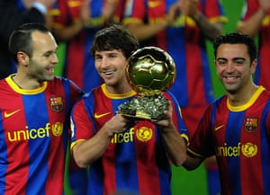 Lionel Messi, poses alongside fellow La Masia graduates Xavi Hernandez and Andrés Iniesta after winning the 2010 Ballon d'Or trophy