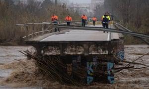 Police inspect a bridge brought down by Storm Gloria, in Malgrat de Mar, near Girona.