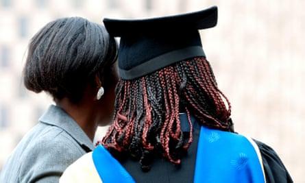 University graduate poses for photograph.