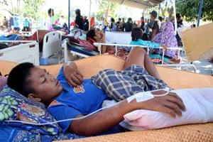 An injured boy rests at a makeshift hospital in Pemenang, North Lombok.