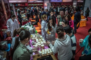 Visitors taste products during a tea expo, where there are many varieties on offer such as green, black, oolong, white and yellow tea