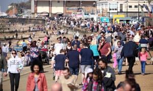 People walk on the promenade in Hunstanton, Norfolk.